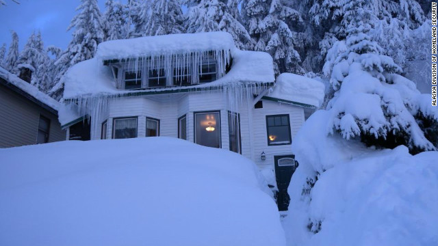 Alaska town digging its way out after record 18 feet of snow