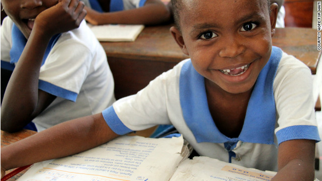 Young students sit in class at a school sponsored by Hope for Haiti. This school year, Hope for Haiti provided books to students through the Book Share Project.