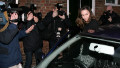 Kate Middleton is surrounded by photographers as she leaves her flat in Chelsea, London, on her 25th birthday, January 9, 2007.