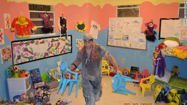 CAN-DO founder Eric Klein puts the finishing touches on a room at the newly reconstructed Bless A Child Orphanage. The orphanage, which suffered structural damage in the quake, is now home to more than 30 children ages 4 to 14.