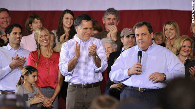 Mitt Romney looks on as New Jersey Gov. Chris Christie speaks to supporters in Exeter, New Hampshire, on Sunday.