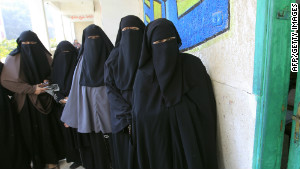 Egyptian women wait to vote at a Cairo polling station in January 2012.