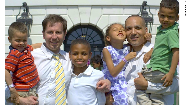 Frederic Deloizy, left, and Mark Himes, with their four children in April 2010.