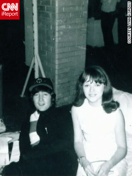 "iReporter Lynn Kordus said her most memorable ""Kodak moment"" was with the Beatles in 1965. Here she poses with John Lennon while he thumbs through a magazine. <a href='http://ireport.cnn.com/topics/726798'>See more Kodak moments on CNN iReport.</a>"