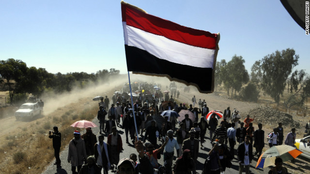 Yemeni protesters march in Dhamar during a rally on December 23.
