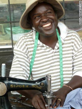 A man at work using an old Singer sewing machine that he found and maintains himself.
