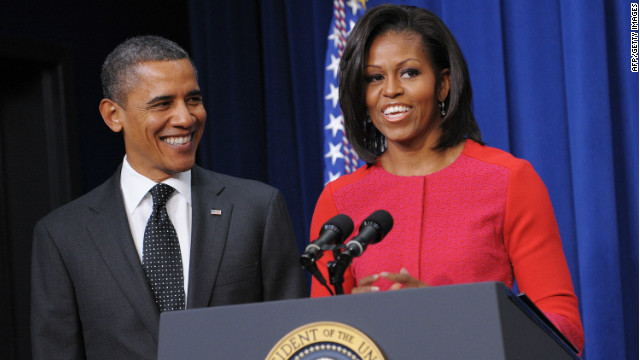 First lady Michelle Obama speaks as President Barack Obama looks on during a recent signing ceremony at the White House.