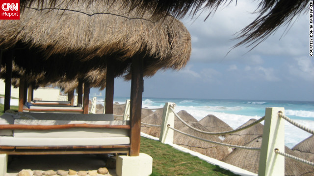 Donna Panabaker captured this view from a palapa in Cancun. &quot;If there's something more relaxing than lounging in a shaded, comfy bed while overlooking a beautiful beach like this one, I don't know what it is!&quot;