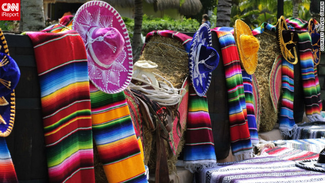 "Steven O'Brien shot this photo of ""a simple display of blankets and hats that bring out all the vibrant colors of Mexico."""