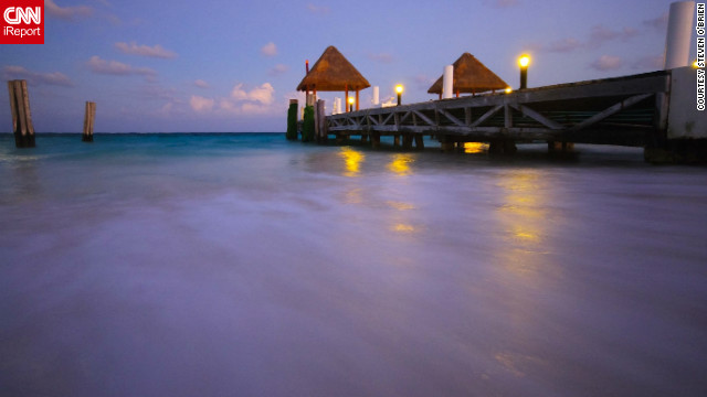 "Steven O'Brien captured this breathtaking perspective. ""As the sun started setting of this pier on the Riviera Maya, the moon was high and cast a wonderful light on the water."""