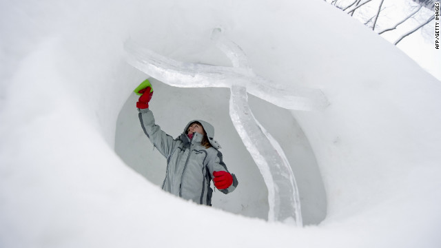 A woman works on a sculpture January 10 to be displayed at a snow festival in Moroz (Frost) City in Moscow.