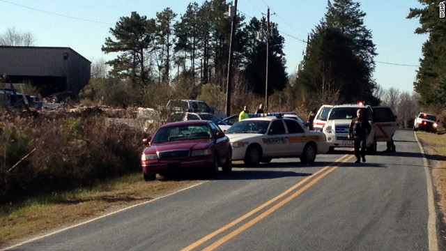 Three people were killed and a fourth wounded in a shooting Friday at a lumber company in North Carolina, police said.