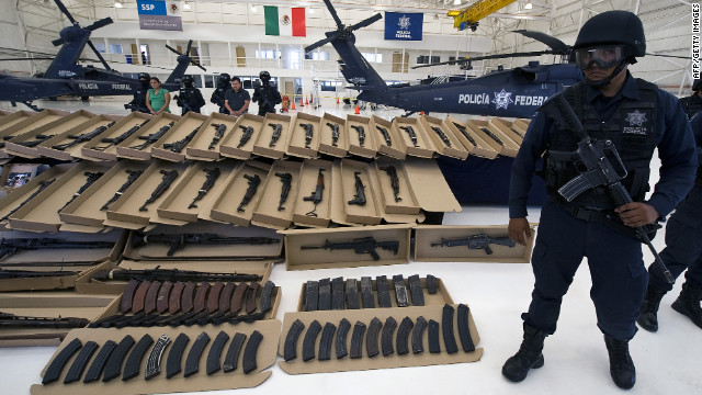 The cartels arm themselves heavily. Here, Mexican Federal Police display a large cache of high-powered weapons, grenades, ammunition and 2 kilos of cocaine, all seized from the Zetas cartel in October 2010.