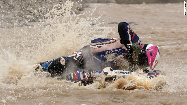The Dakar tests racers both physically and mentally as they take on a variety of challenging terrains. This picture shows Yamaha rider David Barrot falling into a river in Peru during the 11th stage in 2012. 