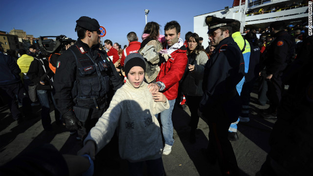 Passengers arrive at Porto Santo Stefano, Italy, after being evacuated from the ship.
