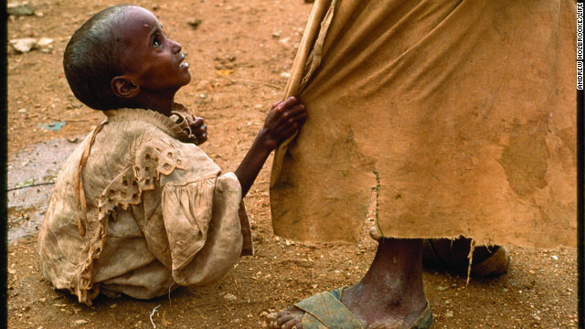 The photographs that appeared in LIFE magazine helped cement LIFE's reputation as the photography magazine of the 20th century. Photographer Andrew Holbrooke captured a starving girl pulling at her brother's robe at a Somali feeding station in 1992. Click through the gallery to see a selection of some of LIFE's most powerful images.