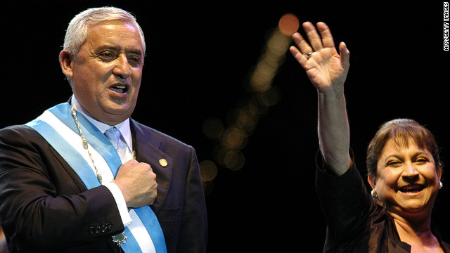 Guatemala's new President Otto Perez and his wife Rosa Leal wave to supporters in Guatemala City, January 14, 2012.