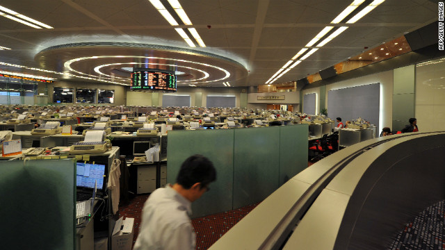 Asian markets have eased after an agency downgraded the credit ratings of nine eurozone countries.