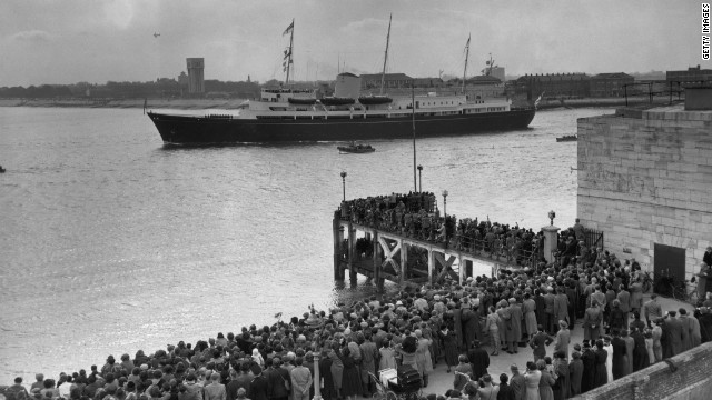 Crowds gather to bid the Britannia farewell at Portsmouth in April 1954 when she was transporting Prince Charles and Princess Anne to Tubruq to join their parents on the last stage of a Commonwealth Tour. 