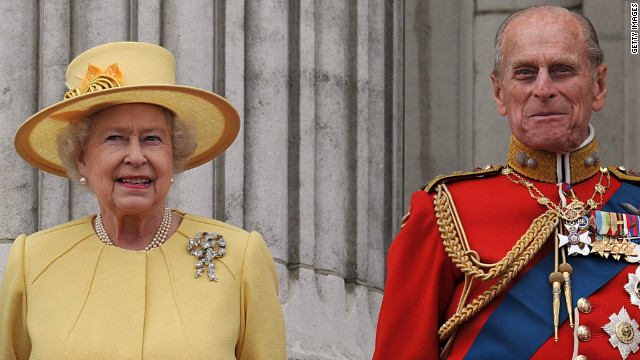 Queen Elizabeth II and Prince Philip on the balcony at Buckingham Palace after the Royal Wedding of Prince William to Catherine Middleton on April 29, 2011 in London, England.