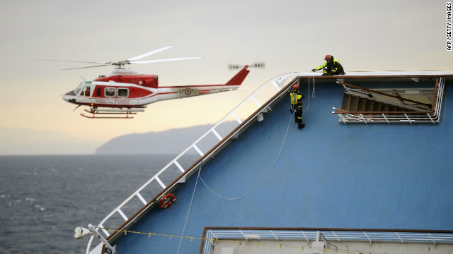 Firemen work on the Costa Concordia cruise ship on January 16. The captain may have made &quot;significant&quot; errors that led to wreck, the cruise line said.