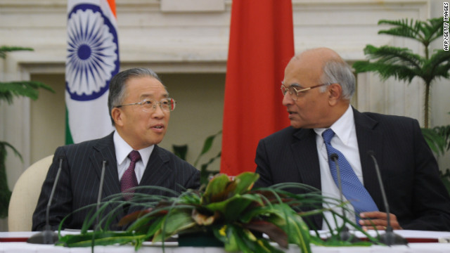 China's representative on the boundary question talks with India's national security advisor during a signing agreement on January 17, 2012.