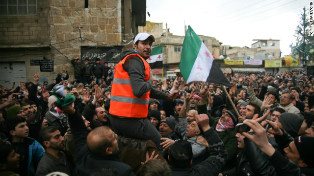 An Arab league monitor is carried though the crowd in Zabadani, Syria on January 15, 2012.