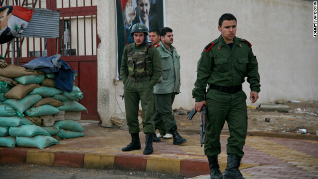 Military checkpoints guard the way into the town of Kisweh.