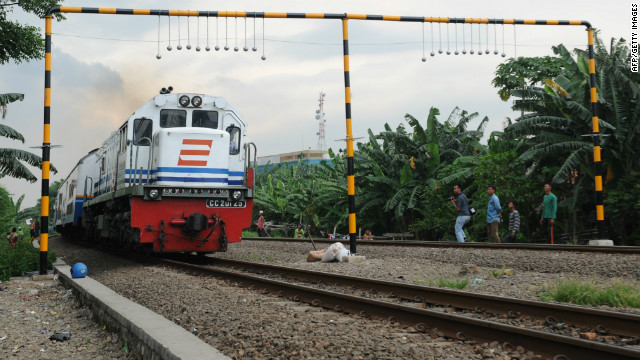 Reports: Concrete balls keeping some off Indonesian train roofs