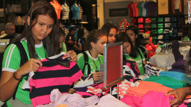 Brazilian tourists in Central Florida spend the day shopping at the Orlando Premium Outlets near Disney World.