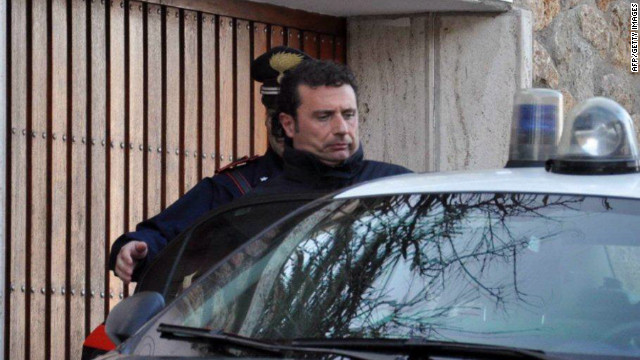 The captain of the Costa Concordia cruise liner Francesco Schettino is escorted by an Italian policeman in Grosseto on January 14, 2012.