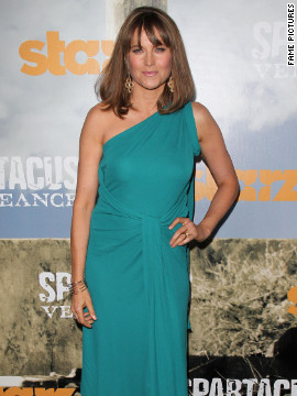 Lucy Lawless attends a premiere in Hollywood.