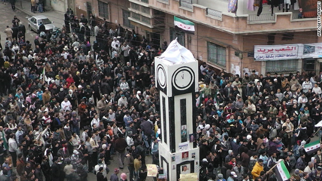 Supporters of the Free Syrian Army (FSA) gather in the flashpoint city of Homs on January 13, 2012.