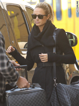 Stacy Keibler catches a flight from Los Angeles airport.