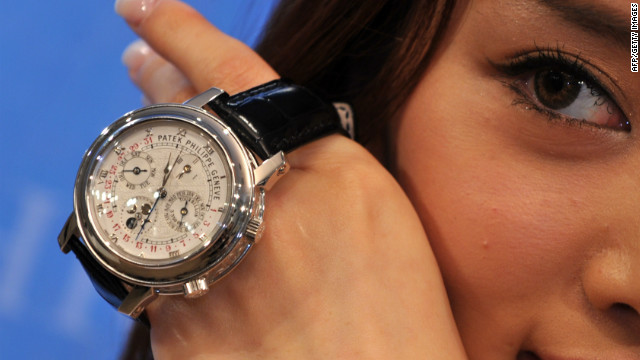 A model holds a Patek Philippe Sky Moon Tourbillon during an auction in Hong Kong.