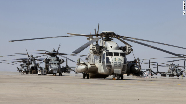 U.S. Marine CH-53D Sea Stallion helicopter, Marine Heavy Helicopter Squadron 463, remain docked along the flight line of HMH-463 for maintenance checks and repairs, Camp Bastion, Afghanistan, May 6, 2011.