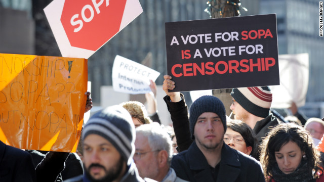 Opponents of legislation targeting Internet piracy demonstrate outside the offices of New York's U.S. senators in January.