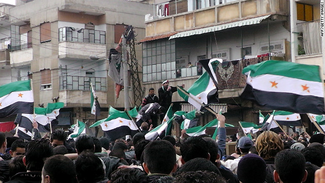 Syrian anti-regime demonstrators wave flags in the Khalidiya neighbourhood of the flashpoint city of Homs on January 20, 2012.