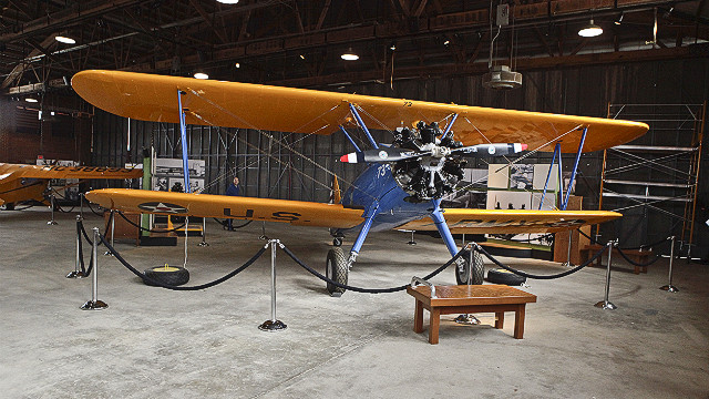 A Stearman PT-17 sits on exhibit in Hangar No. 1 at the Tuskegee Airmen National Historic Site. The hangar is restored to the way it would have looked in the 1940s. Visitors can walk through the offices and training areas and learn about the heroic pilots firsthand.