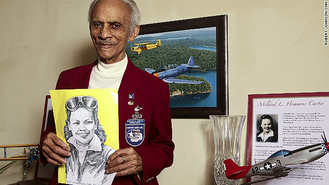 Herbert Carter, 94, one of the original 33 Tuskegee Airmen pilots, holds a portrait of his wife, Mildred Hemmon Carter, in her flight uniform. She was the first black female pilot in Alabama and is counted among the history-making Tuskegee Airmen, too. He eventually rose to the rank of lieutenant colonel. Married nearly 70 years, the two were known as Tuskegee's &quot;first couple.&quot;