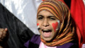 An Egyptian girl shouts slogans against the military in Cairo's Tahrir Square on December 23, 2011 as people gathered for a mass rally against the ruling military, which sparked outrage when its soldiers were taped beating women protesters.