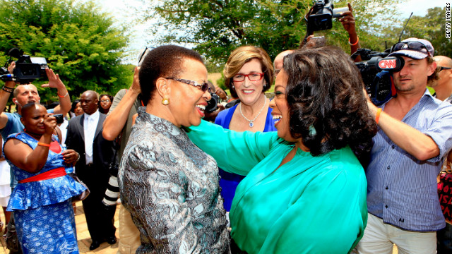 <br/>Winfrey greets Graca Machel, the wife of former South African president Nelson Mandela, on her arrival at the inaugural graduation of the class of 2011.