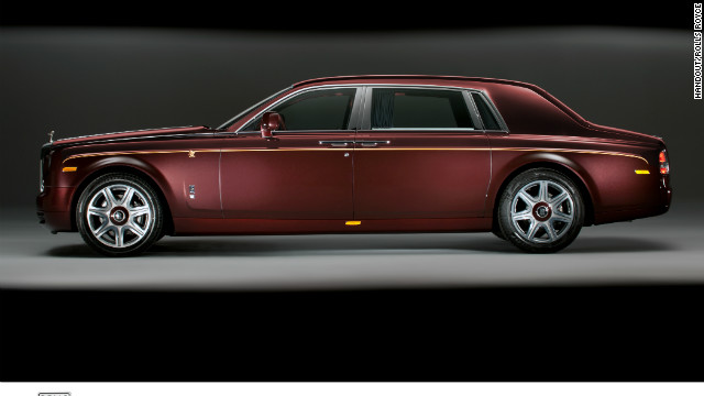 "Rolls Royce Motor Cars' ""Year of the Dragon"" Collection features gold dragons painted on the sides of the car and embroidered into the headrests and rear seat cushions."