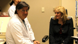 Dr. Steven Schwartz and a 51-year-old patient who says her vision has improved after stem cell treatment.