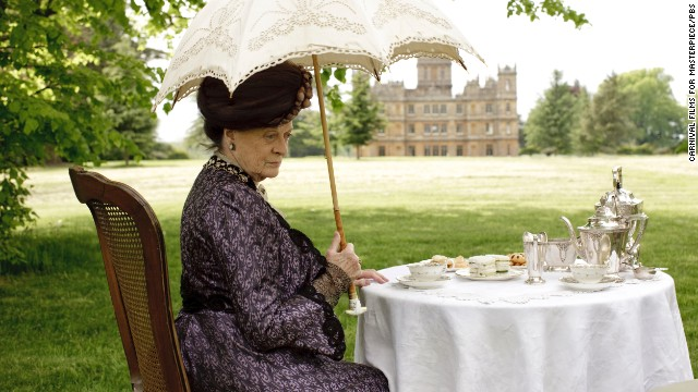 <br/>The gorgeous grounds of the castle are a big allure of the show. Here, Dame Maggie Smith, who plays the Dowager Countess of Grantham, has tea outside.