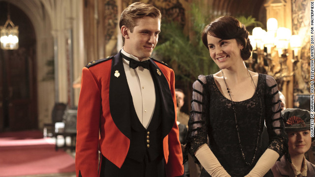 <br/>The series shows off the castle's sumptuous interiors. Here, Dan Stevens as Matthew Crawley and Michelle Dockery as Lady Mary share a scene.