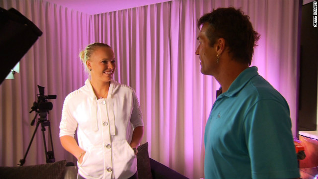 Wozniacki chats with Open Court's Pat Cash prior to her interview with the former Wimbledon champion.