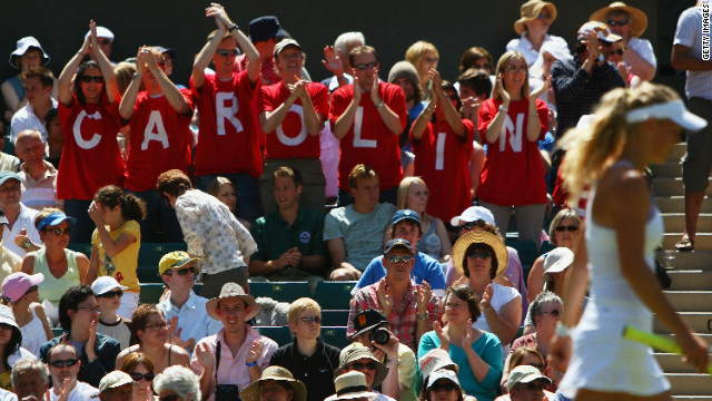 Wozniacki is a crowd favorite wherever she goes. Here at Wimbledon, fans show their support for the Danish star during last year's tournament, wearing t-shirts that spell out her name.