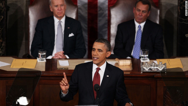 President Obama, flanked by Vice President Joe Biden and House Speaker John Boehner, gives the State of the Union address .