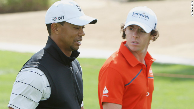 Rory McIlroy (right) will play with Tiger Woods in the opening two rounds of the Abu Dhabi Golf Championship.